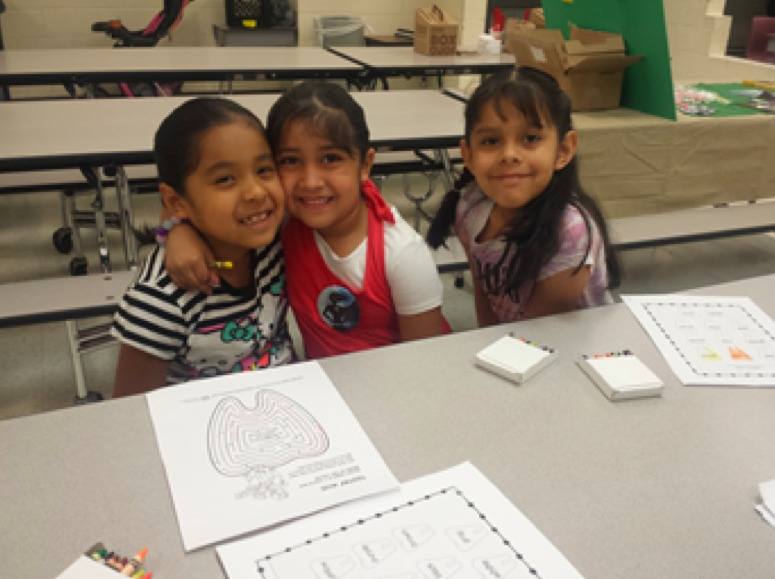 Three of Jazmin's children at their public school in Chicago.